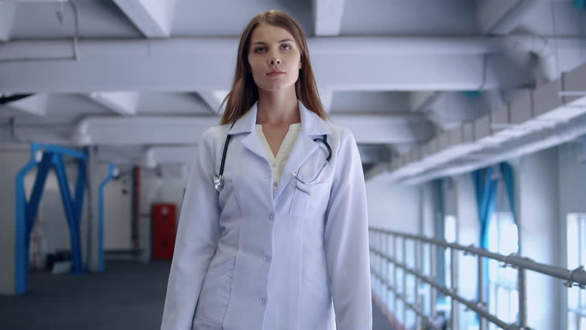 Woman cardiologist move in clinic. doctor wearing white lab coat with stethoscope walking in hospital. | Shutterstock HD Video #1022711152