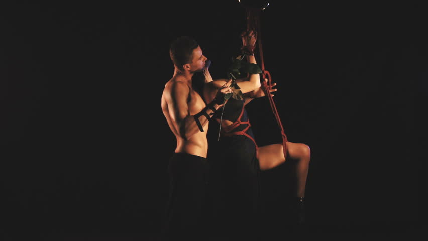 A couple in a intimal moment. Man and woman. Bdsm theme | Shutterstock HD Video #1022715952