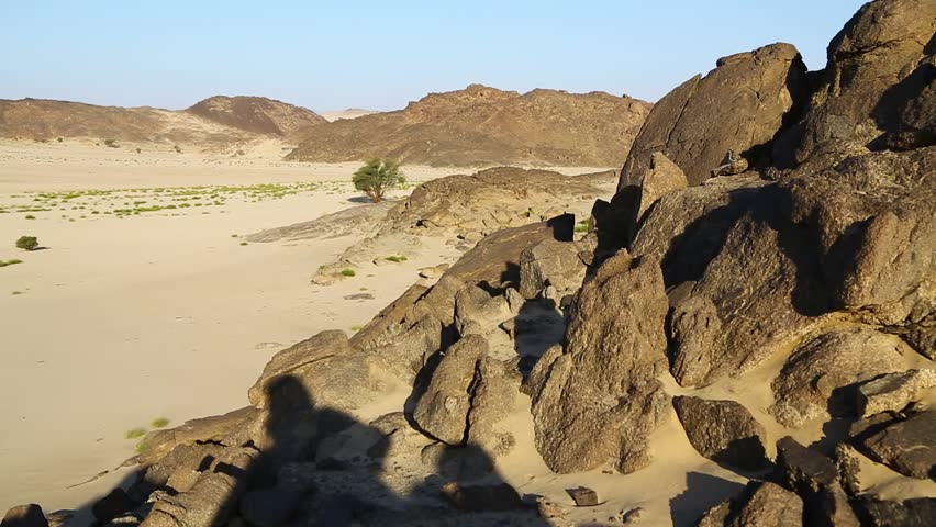 In the middle of the desert rock and track like concept of wild and nature scenic land   | Shutterstock HD Video #1022804932
