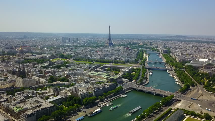 AERIAL: Over Paris Old Town and Park looking towards Eiffel Tower // Summer, Daylight | Shutterstock HD Video #1022812132