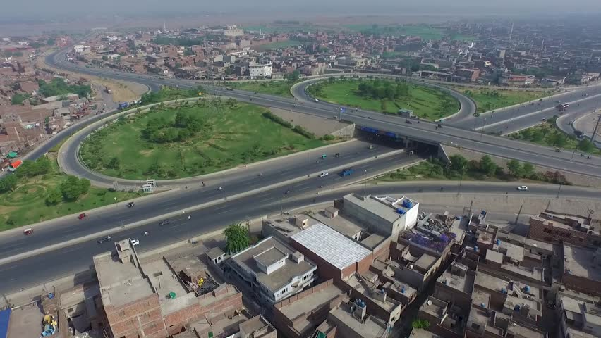 Aerial fly over or a new section of Lahore's new Ring Road in Pakistan | Shutterstock HD Video #1022842312