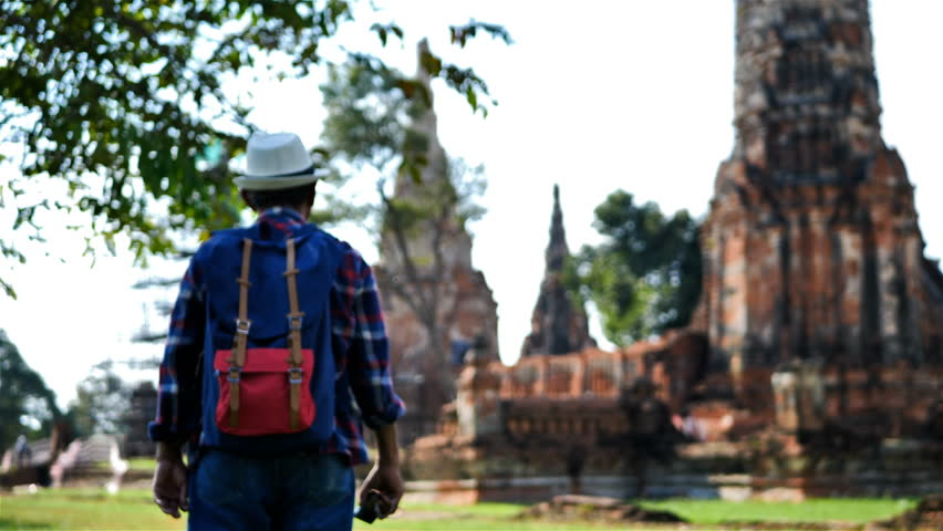 Senior man Asian with backpack are walking at Wat Chaiwatthanaram. Ancient and historical attractions and one of the most important archaeology of Ayutthaya province thailand. Travel, Tourist Concept | Shutterstock HD Video #1022862022