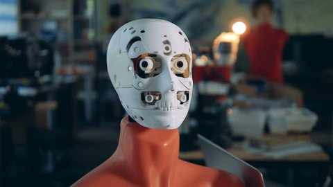 Robotic head attached to a mannequin body is moving its eyes