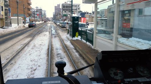 Sapporo Street Car View Outside Window on Traffic and Slushy Road in Winter - Sapporo, Japan - December, 2018