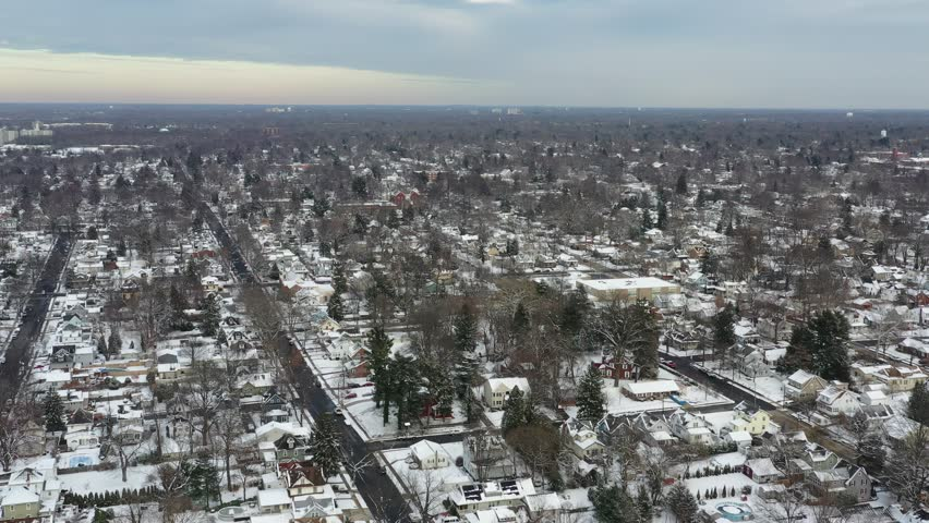 Aerial View Small Town After a Snowfall   Shutterstock HD Video #1023021892