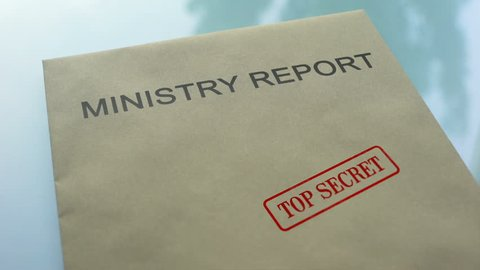 Ministry report top secret, stamping seal on folder with important documents