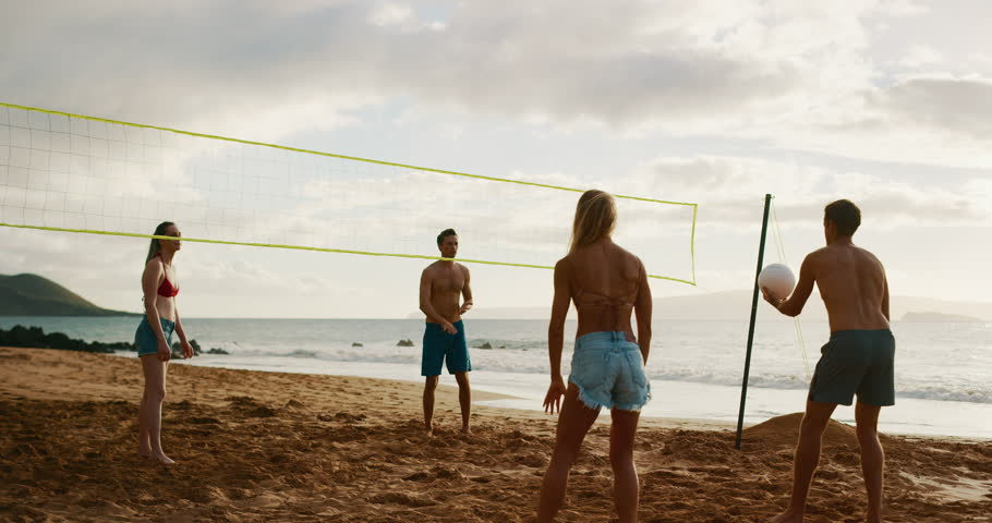 Active friends playing beach volleyball, slow motion serve set rally | Shutterstock HD Video #1023104602