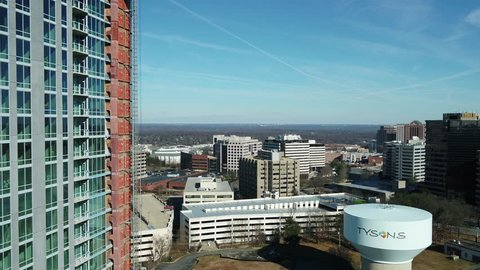 Tysons, VA / USA - December 29 2018: Aerial pedestal with new construction in left of frame, showing Tysons water tower and skyline