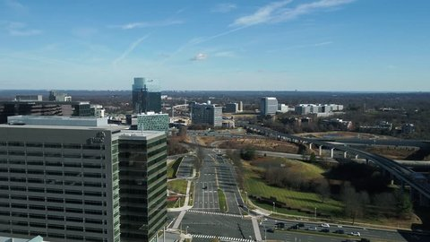 Tysons, VA / USA - December 29 2018: Pedestal rise looking down Galleria Drive showing the Capital Beltway and the DC Metro Silver line.