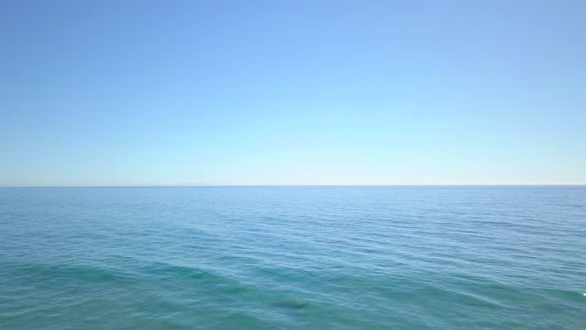 Drone shot of open oceaning forward