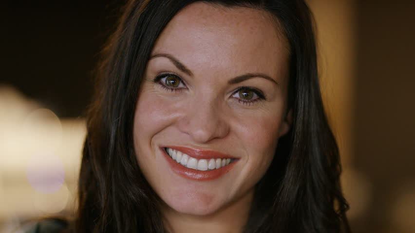 Portrait of happy brunette female smiling to camera  #1023129262