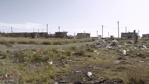 The wind blows litter and trash outside a shanty town in South Africa.