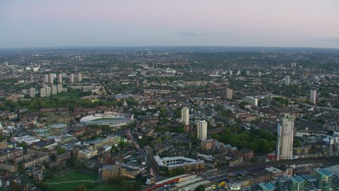 London - November 2017: Aerial sunset view London cityscape The Oval cricket ground MI6 Building commuter vehicles and public transport England UK RED WEAPON
