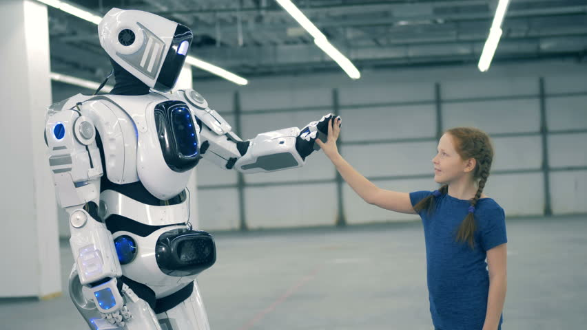 Cybrog is giving a high-five to a little girl | Shutterstock HD Video #1023238702