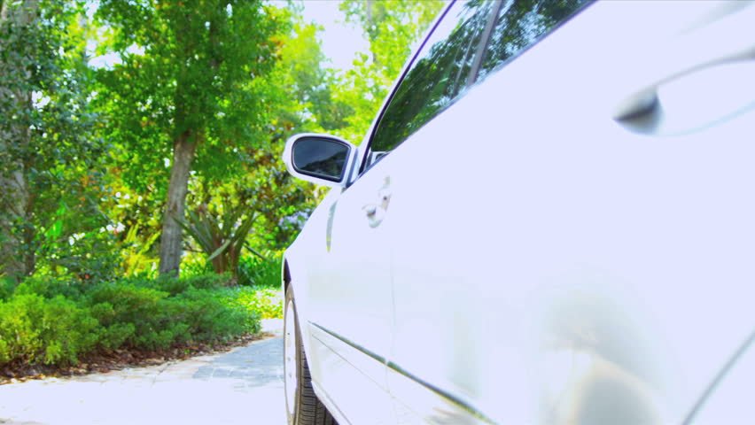 Close up Caucasian businessman arriving outside home luxury car  #1023276652