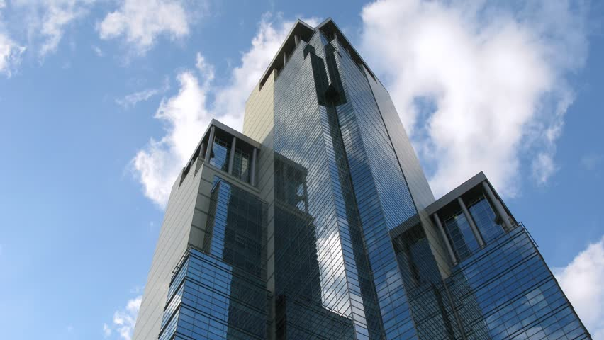 Clouds reflect in newly build skyscraper in Moscow, time lapse #1023322