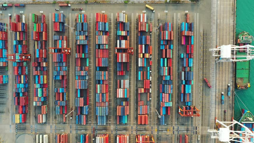 Aerial view. top view container ship in pier with crane bridge carries out export and import business in the sea. Logistics and transportation #1023410992