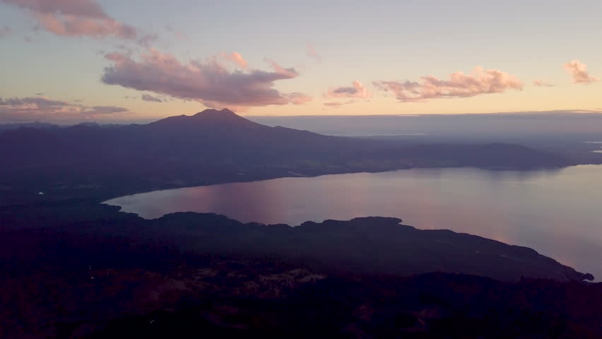 Tilt up to Calbuco volcano and lake in southern Chile at dusk | Shutterstock HD Video #1023433462