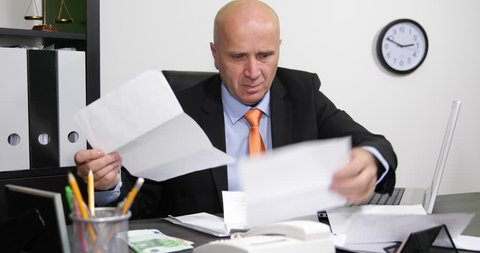 Nervous Businessman Check Documents Invoices and Payments Disappointed