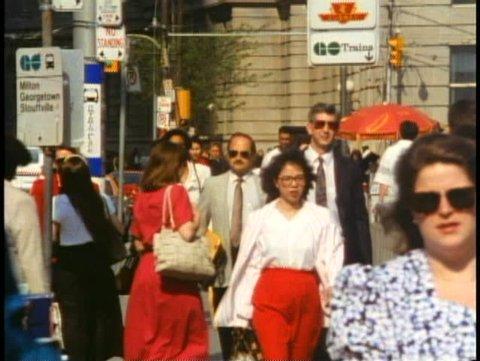 TORONTO, ONTARIO, 1990, Crowd on streets, crushed shot