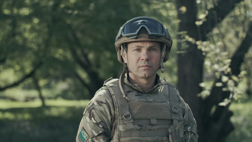 Portrait Of A Soldier. Sadness And Pity On The Face. | Shutterstock HD Video #1023552652