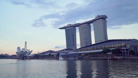 SINGAPORE - CIRCA MAY 2017:  Singapore city skyline with famous Marina Bay Sands hotel reflected in Marina bay harbor, Singapore.