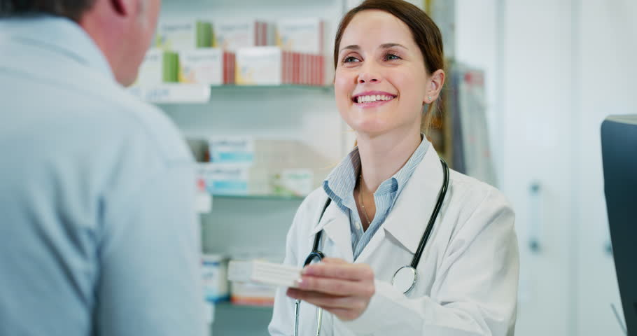 Slow motion of young woman pharmacist handing over prescribed medicines to a patient in drugs store. Shot in 8K. Concept of profession, medicine and healthcare, medical education,pharmaceutical sector | Shutterstock HD Video #1023572122