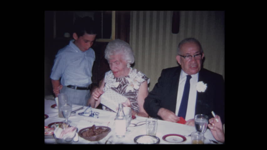 1971 Boy gives elderly grandparents funny gift at anniversary party