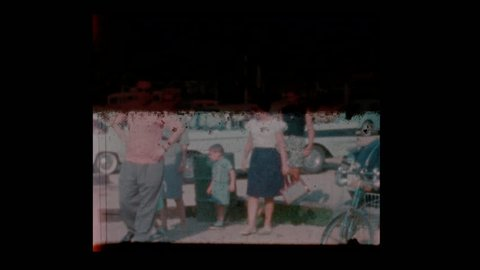 1963 Family in parking lot with vintage antique cars