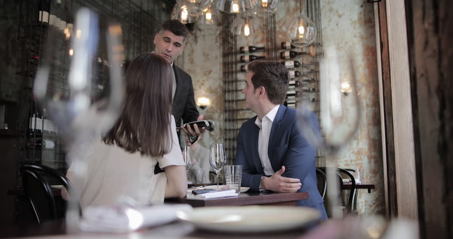 Businessman paying for meal in a restaurant   Shutterstock HD Video #1023645982
