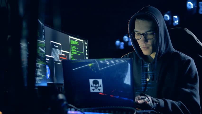One man works with a laptop, hacking system, close up.   Shutterstock HD Video #1023728272