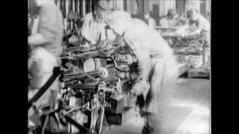 CIRCA 1920s - Good assembly line Ford factory footage with workers from the 1920s.