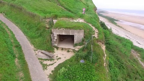 Aerial view hovering in front of open bunker structure on Omaha beach, Normandy, France.