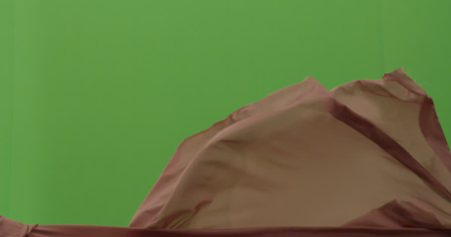 Abstract material floating cloth fabric against green screen in slow motion    Shutterstock HD Video #1023831322