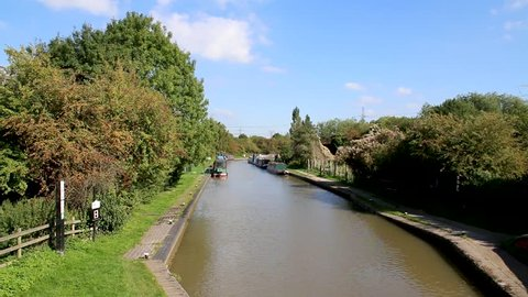 Coventry, Warwickshire, UK - October 1, 2015:  Quiet canal at Hawkesbury junction near Coventry with moored boats on an autumn day