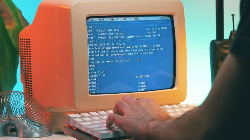 MONTREAL, CANADA - February 2019 :   Using a vintage computer from the late 80s early 90s to work on a desk. Retro screen and background. | Shutterstock HD Video #1023857452