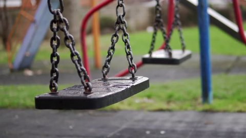 Cinematic Empty Swings In Playground, Child Abduction Concept