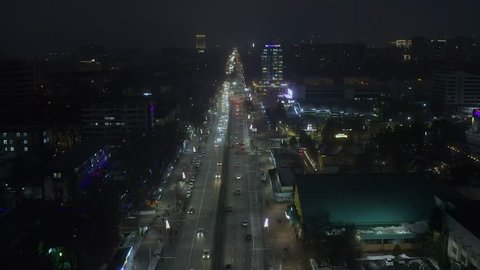 Almaty, Kazakhstan - January 07 2019: Night flight forward above Abay avenue This is main avenue in downtown of Almaty.