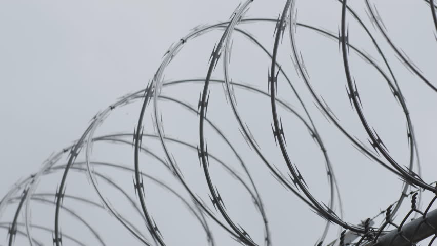 Barbed Razor Wire Fence Prison Stock Footage Video 100 Royalty