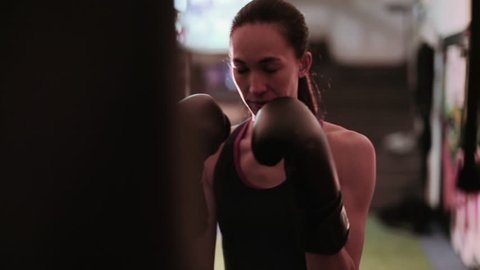 Female boxer training with a punch bag