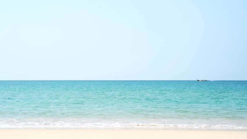 Tropical beach afternoon view,  of the plane is down near the airport. tropical white sand beach. Sea waves seamless loop on the beautiful sand beach,Phuket Thailand.  | Shutterstock HD Video #1023971372