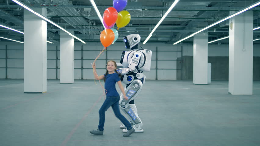 Happy girl with balloons is running around an anthropoid robot | Shutterstock HD Video #1024036982