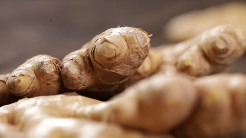 Ginger Root Falling onto other Ginger Roots, Closeup