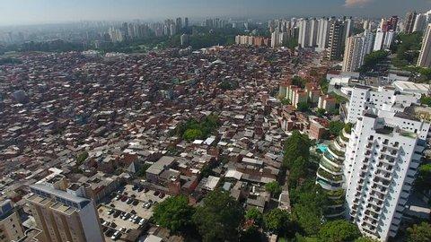 São Paulo, São Paulo / Brazil - 01/26/2019: Aerial view of Paraisópolis slum and luxury builidings of Giovanni Gronchi Avenue, a symbol of brasilian social contrast