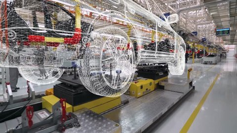 BELARUS, BORISOV - OCTOBER 19, 2017: Automobile plant, view of hologram projections of cars and power units, motion graphics in modern production of cars, car model visualization, assembly line.