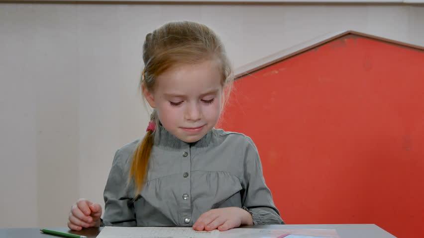 Tired and bored little preschool girl sleep on homework desk. Pretty female pupil do homework and school exercises. Home education concept | Shutterstock HD Video #1024112222