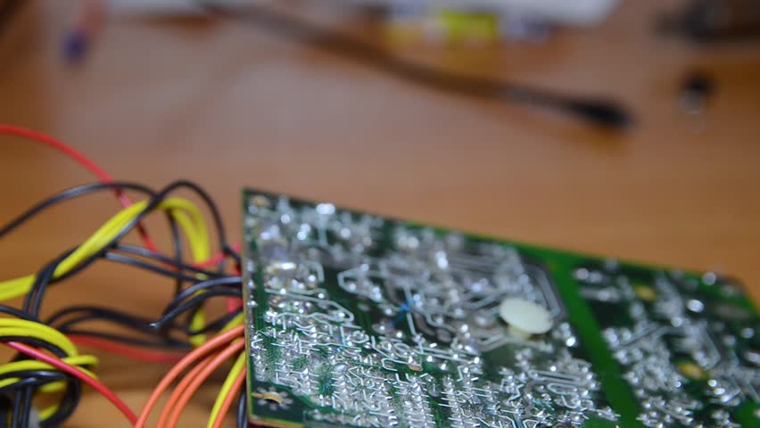 Repair of electronic devices, soldering parts. The master solders, repairs the board. | Shutterstock HD Video #1024155272