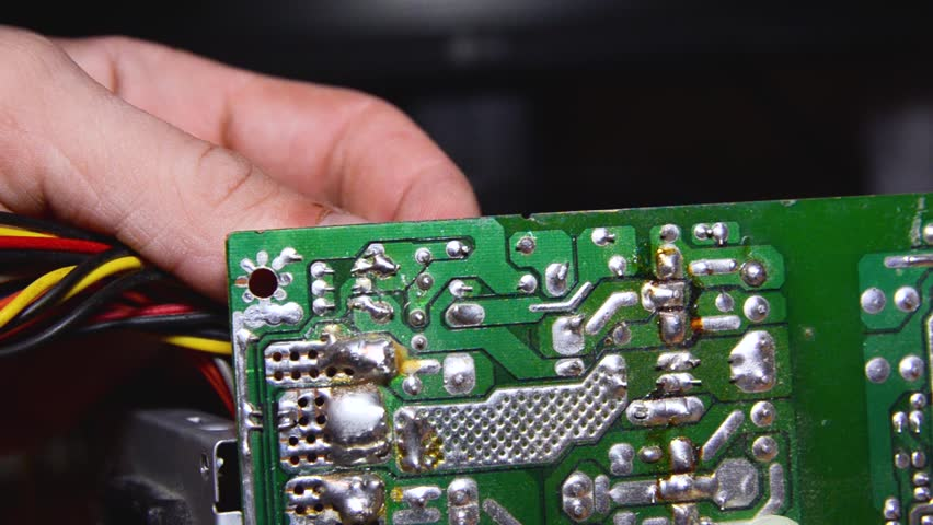 Repair of electronic devices, soldering parts. The master solders, repairs the board. solder wires | Shutterstock HD Video #1024155302