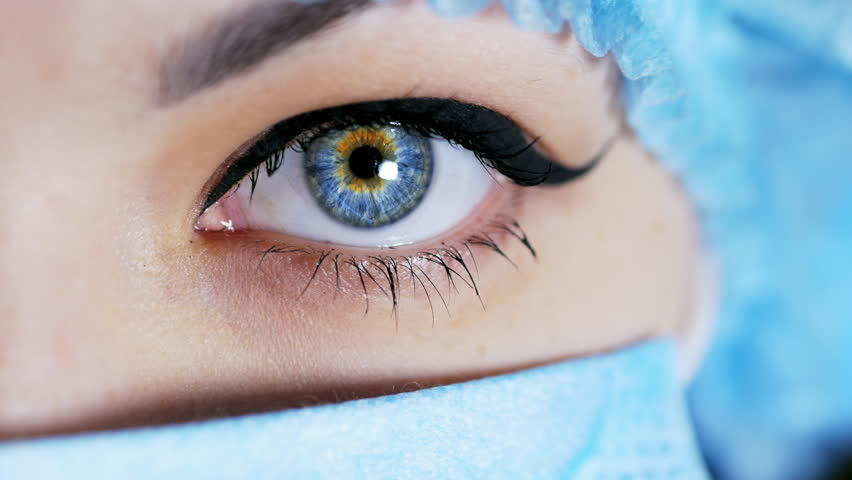 Woman's surgeon eye, doctor looking at camera in close-up, medicine concept #1024166102