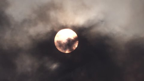 Sun covered by black clouds of smoke